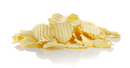 Heap of unflavored ridged potato chips on reflective surface. Stock Photo