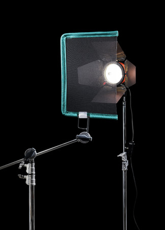 reducing: Single Open-End Black Scrim. Scrims like these are used for reducing intensity of the light in cinematography. Stock Photo
