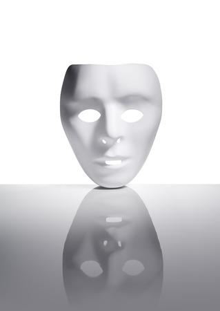 reflective: White plastic mask on reflective surface.