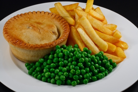 pomme de terre: Pie and chips with peas  A traditional British Bar Dish Stock Photo