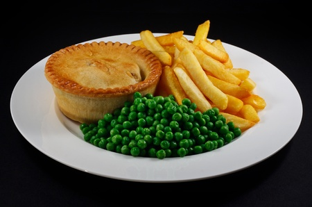 Pie and chips with peas  A traditional British Bar Dish Stock Photo - 12681910