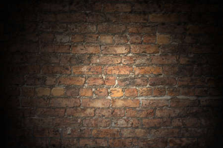 A Plain Red Brick wall old and worn with grey aged grouting, a good background with room for overlaid text, type, poster or Graffiti  photo
