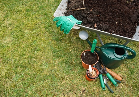 Gardeners utensils on a grass lawn Stock Photo - 12681995