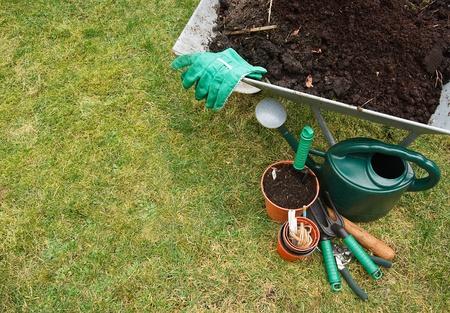 Gardeners utensils on a grass lawn Stock Photo - 12681995