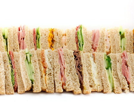 A selection of Sandwiches with various fillings at a buffet with text area photo