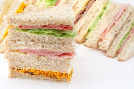 quartered: Selection of Sandwiches in front of a platter of various fillings at buffet Stock Photo