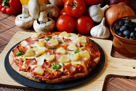 crust: Wood Fired Gourmet pizza with a topping of Ham and Pineapple  Stock Photo