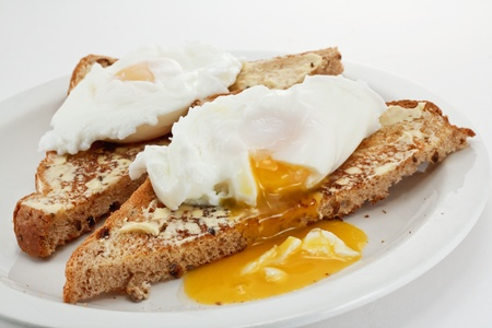 runny: Poached eggs with runny golden yolk