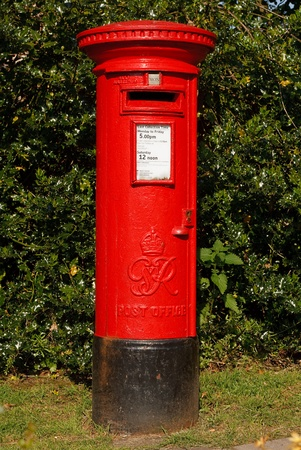 Red victorian mail collection box in a rural village