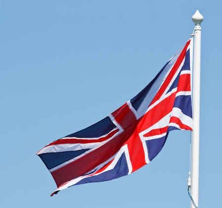 Union Jack Flag flaps in the wind with sky area for text photo