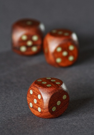 three wooden dice on a grey neutral background Stock Photo - 14255307