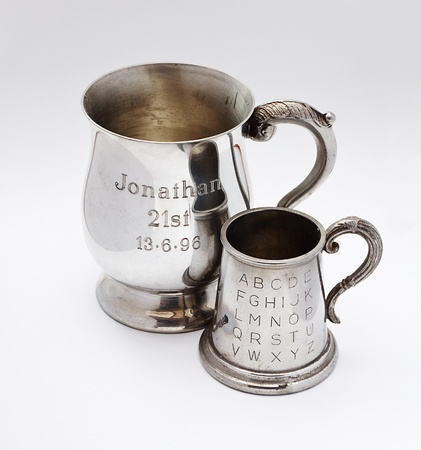personalised: A pair of tankards with engraving celebrating anniversaries on the front Editorial