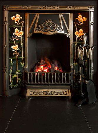 gas fireplace: Traditional tiled fireplace with imitation coal fire Stock Photo
