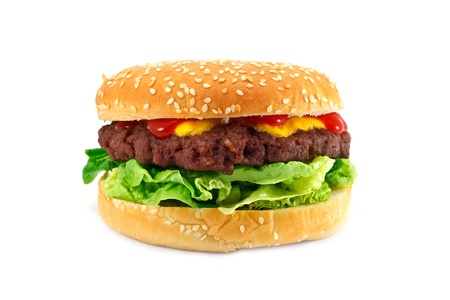 gourmet cheeseburger with a homemade beef patty on a bed of lettuce with ketchup photo