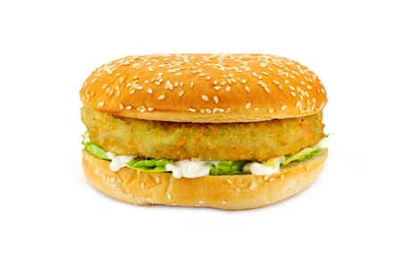 vegetarian hamburger: Breadcrumbed vegetarian or veggie burger, could also be used for chicken burger or fish burger Stock Photo