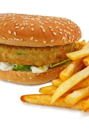 Close up of a breadcrumbed vegetarian or veggie burger and fries, could also be used for chicken burger or fish burger Stock Photo - 14503132