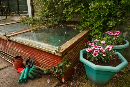 Gardeners Cold frame in the garden, used to protect seedlings from frost during winter Stock Photo - 14503127