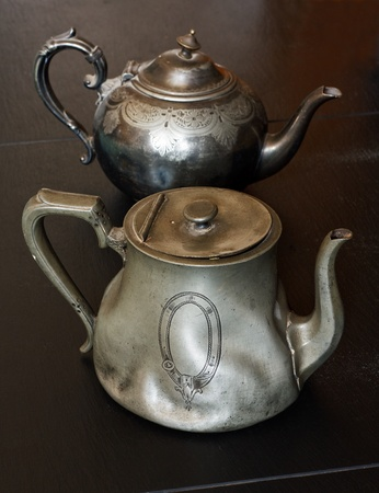 pewter: european traditional pewter teapots you might find in an antiques store or auction Stock Photo