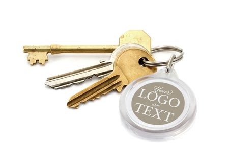 key fob: A set of worn house keys with clear plastic Key fob or tab with copy space for adding of text message or estate agents company logo and details.