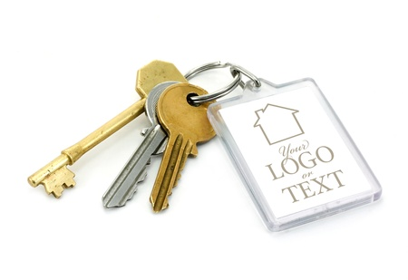 house keys: A set of house keys with clear plastic Key tab with copy space for adding of text message or estate agents company logo and details. Stock Photo