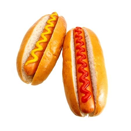 perro caliente: Los perros calientes o Wieners con mostaza y salsa de tomate toppings, el cl�sico original de comida para llevar Foto de archivo