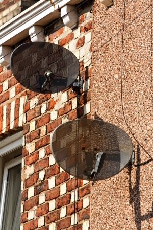 Satellite dishes mounted on residential property photo