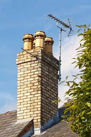 digital television: Terrestrial or digital television aerial on residential chimney Stock Photo