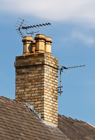 Terrestrial or digital television aerial on house chimney photo