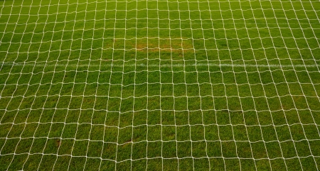 goal net background with grass football pitch or soccer field in america photo