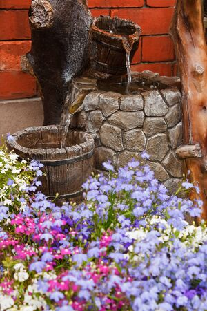 small residential paved garden water feature or waterfall photo