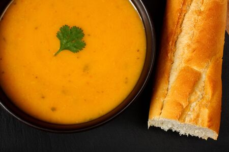 Carrot and coriander soup with bread stick Stock Photo - 14991817