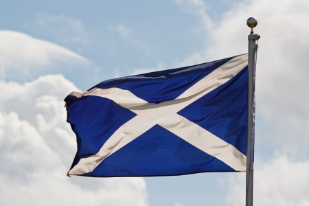 jacobite: the blue and white cross of st andrew the national flag of scotland ripples in the wind on flagpole