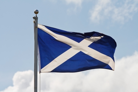 andrew: the blue and white cross of st andrew the national flag of scotland ripples in the wind on flagpole