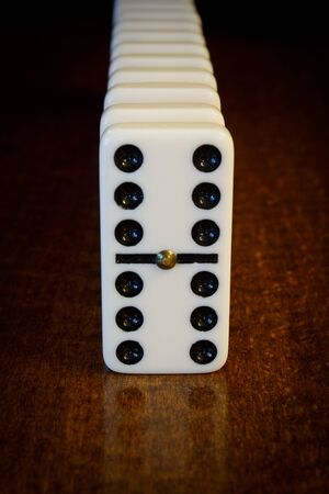 entertainment risk: financial and political concept illustrating impending domino effect or domino theory