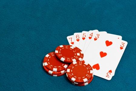 wagers: Una escalera de color una mano ganadora en el juego de cartas de Poker