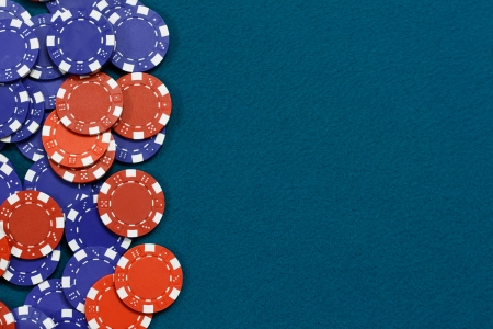 Gambling chips frame on Blue card table background photo
