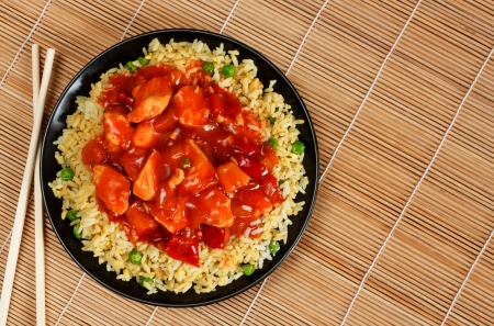 oriental food: sweet and sour chicken with fried rice - popular oriental cuisine Stock Photo