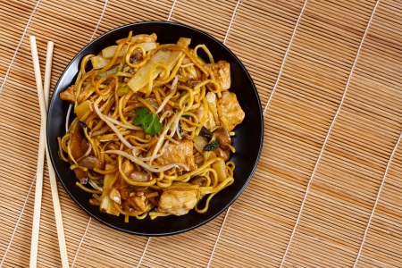 Chicken chow mein a popular oriental dish available at chinese restaurants photo