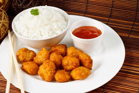 take away: Sweet and sour battered pork balls with boiled rice Stock Photo