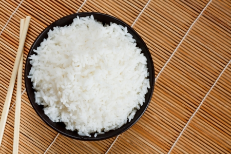 accompaniment: Bowl of boiled rice a popular accompaniment with oriental food Stock Photo