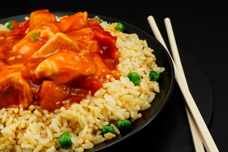 chicken rice: sweet and sour chicken with fried rice a popular take away