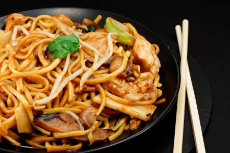 stir fry: Chicken chow mein a popular oriental dish available at chinese take outs