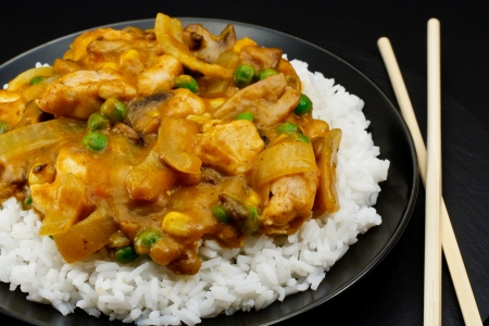stir fry: Chicken Curry a popular oriental dish available at chinese restaurants
