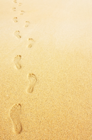 Footprints on the beach background great business concept for travelling photo