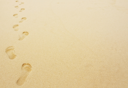 Footprints in the sand background great for vacation adverts photo