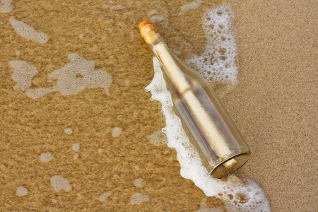 a Message in a bottle washing up on the shore, great business concept for bad or slow communications, or random distribution of spam emails Stock Photo - 15840770