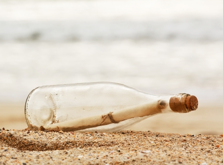 message bottle: a Message in a bottle washed up on the beach, great business concept for snail mail, spam, or bad slow communication