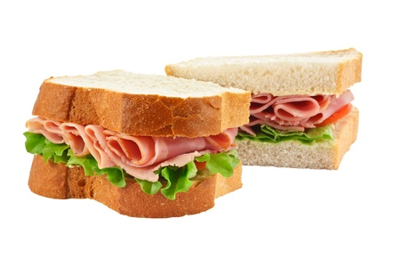 ham sandwich: A ham salad sandwich made with freshly sliced bread cut in half with focus on the filling