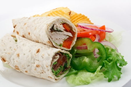 fillings: sliced tortilla wraps a rollup of flatbread with various fillings