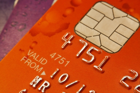 Plastic Bank cards with focus on the Chip and pin security device photo